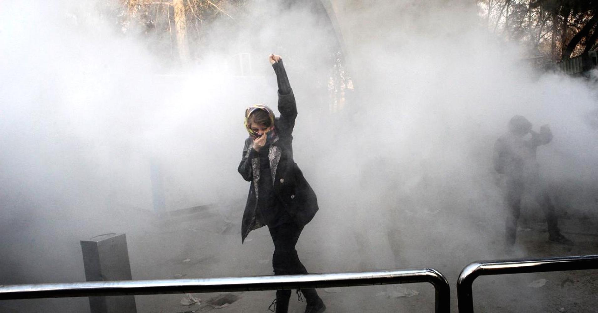 104923765-Iran_woman_protests_.1910x1000